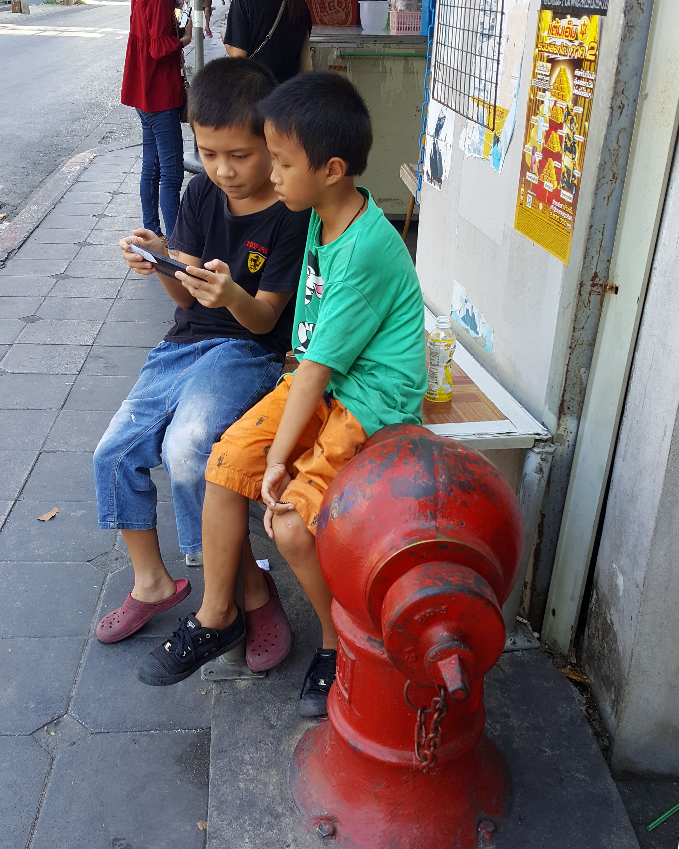 Kids next to a hydrant