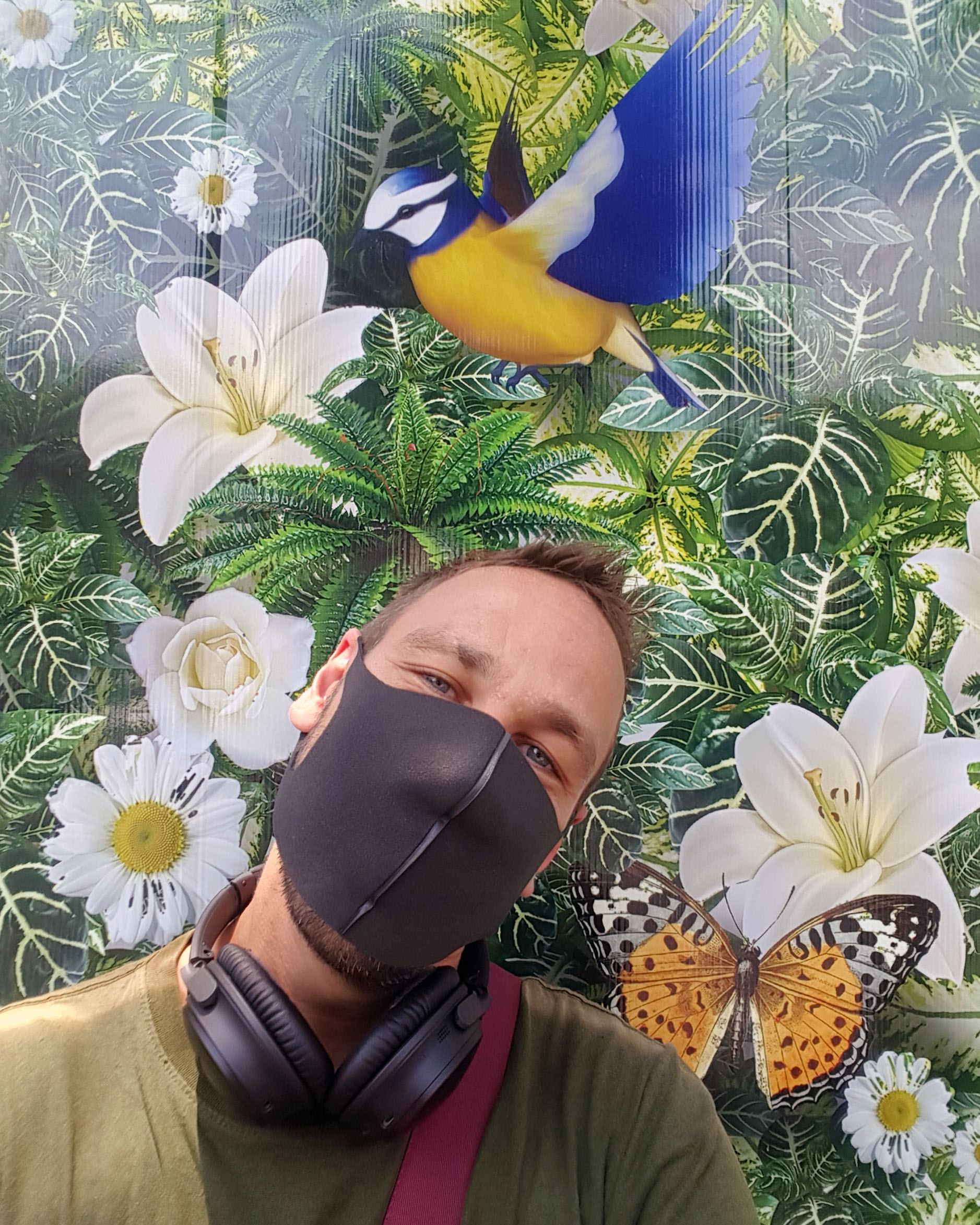 Selfie with mask and tropical background