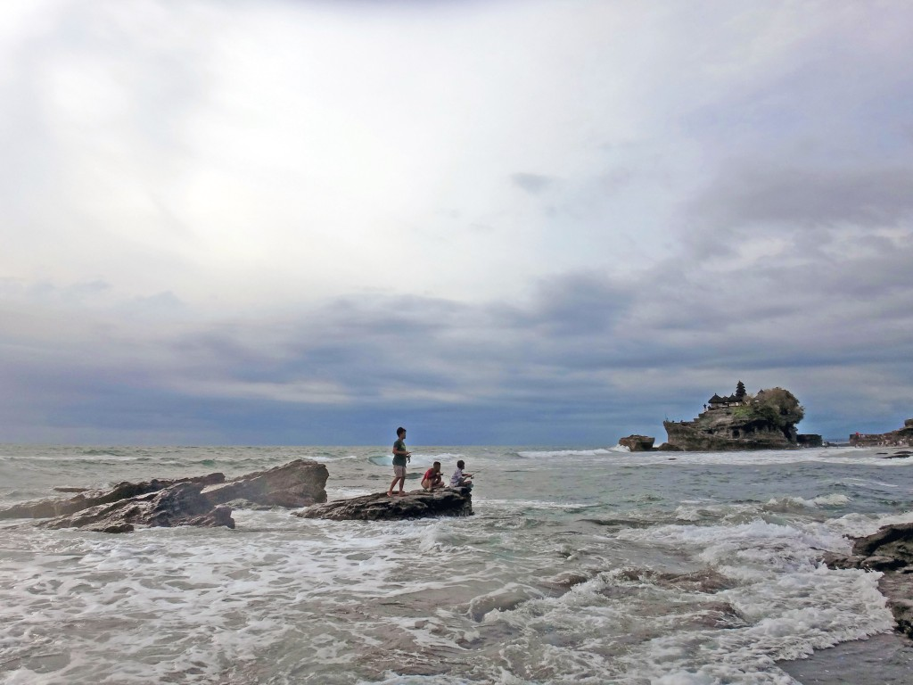 Fishermen in front of Tanah Lot temple, Bali