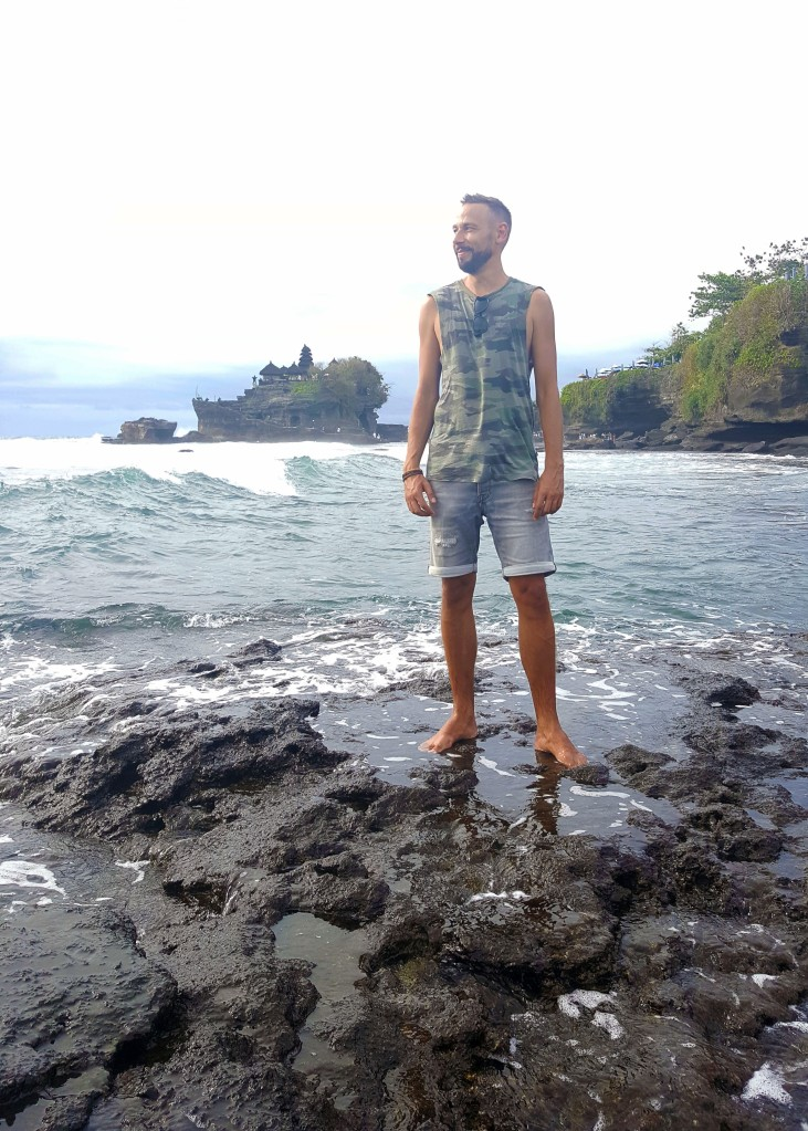 Posing in front of Tanah Lot temple, Bali