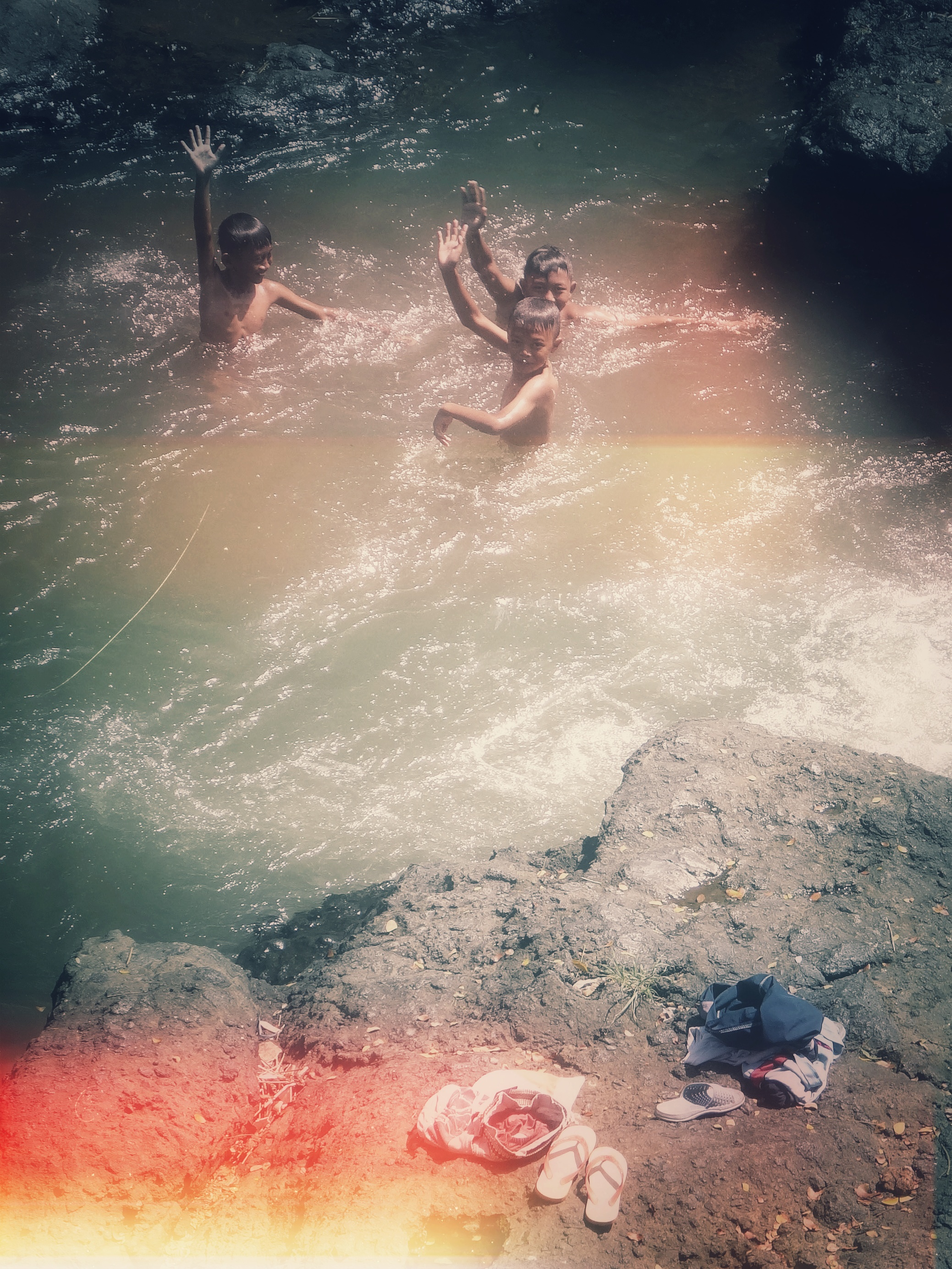 Boys bathing in a river, Java, Indonesia