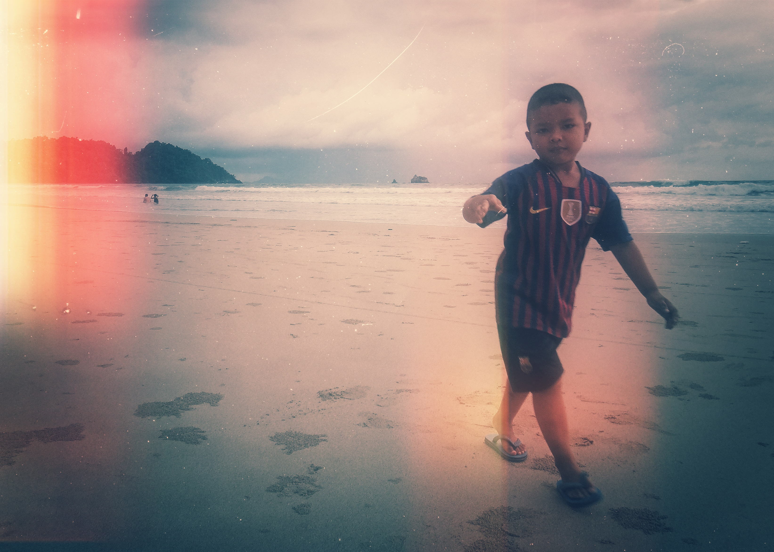 Little boy playing at Long Beach, Koh Phayam