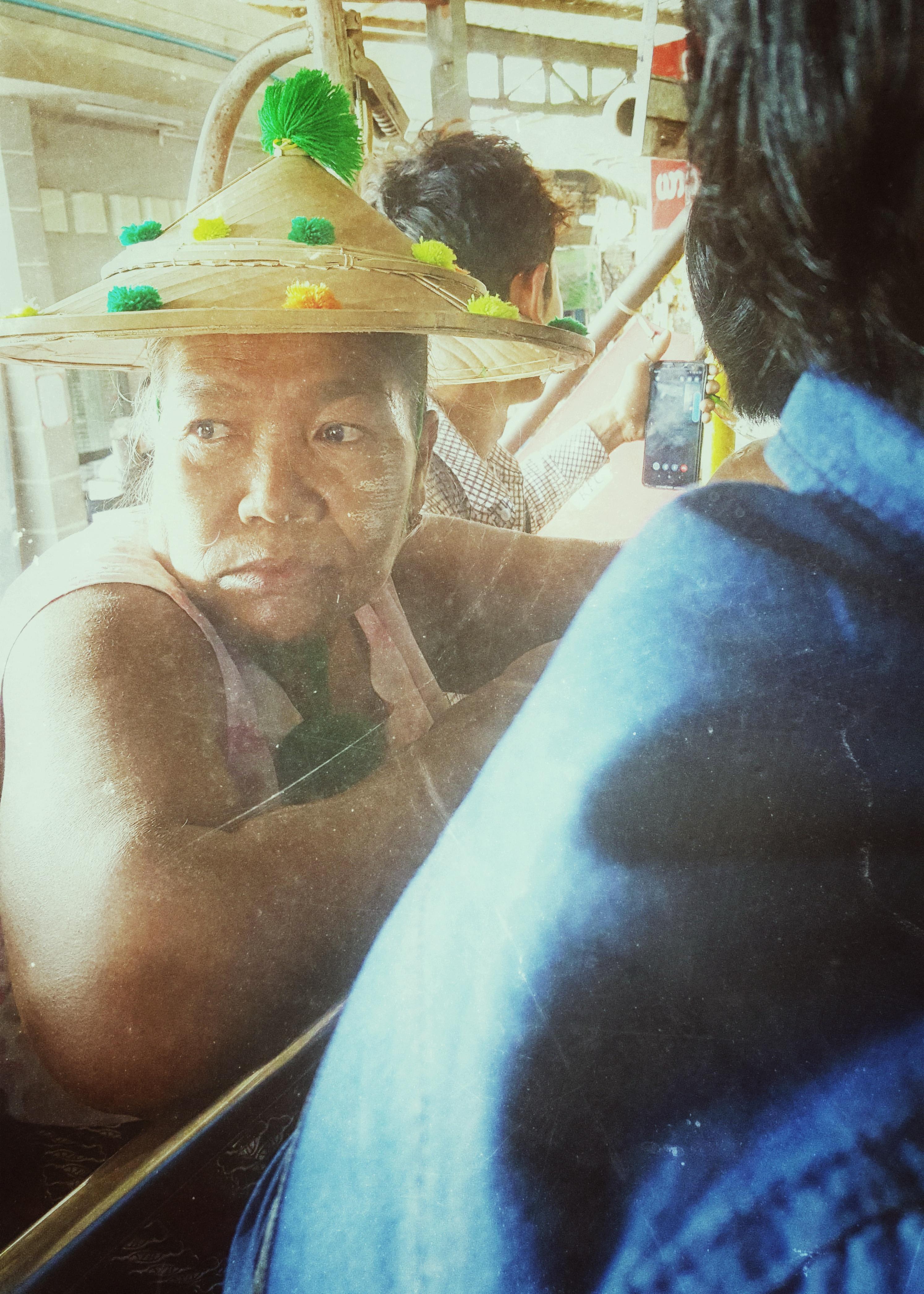 Woman wearing traditional burmese hat, Golden Rock, Myanmar