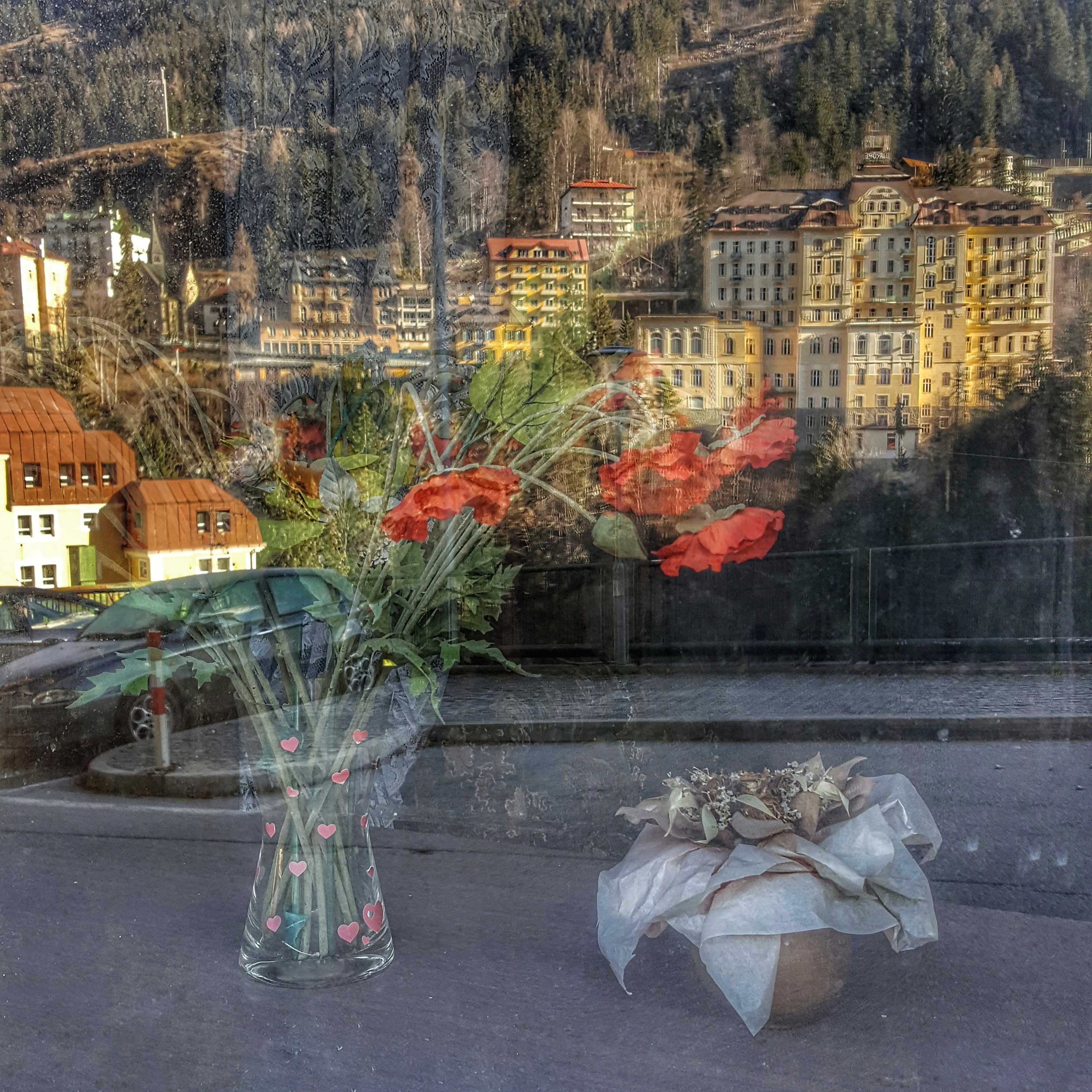 A bouquet of flowers behind a window of Hotel Mirabell